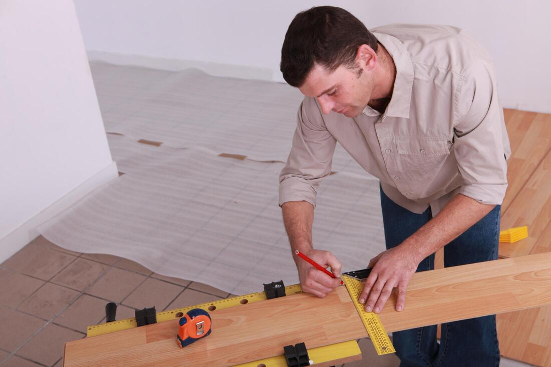 professional flooring services expert during work